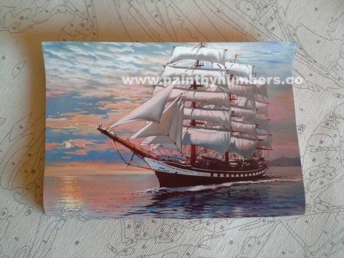 Ship with white sails at sunset2