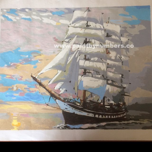Ship with white sails at sunset6